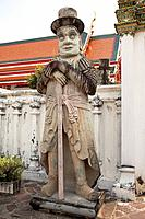 guardian statue at wat pho, temple of the reclining buddha, bangkok, thailand