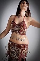 Beautiful brunette practicing belly dancing