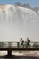 Tourists on a footbridge in front of the Iguazu/Iguaçu falls, Brazilian side, Misiones Province, Argentina, South America, Unesco World Heritage Site ...