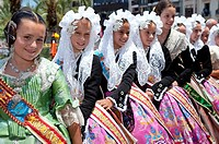 Juvenile fogueres beauties with traditional attire at Hogueras de San Juan, Fogueres de Sant Joan festival  Alicante City, Costa Blanca, Spain, Europe