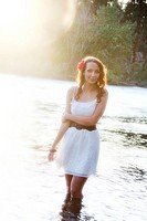 A beautiful young caucasian woman outdoors in Spokane, Washington, USA, standing in the Spokane River