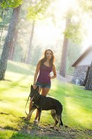 Beautiful young caucasian woman with her German Shepherd dog in Spokane, Washington, USA