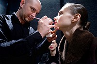 model being made up at a fashion show in milan