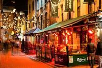 people on the sidewalk outside restaurants and shops, cork city county cork ireland