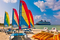 Hobie Cats cataramarans with Disney Dream cruise ship docked at Castaway Cay Disney's private island in background, The Bahamas