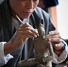 Art Student Sculpting A Clay Figure In National Institute Of Zorig Chusum, Thimphu Bhutan
