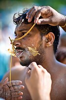 A Young Man In A Ritual Of Tongue Piercing, India