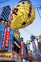 Tsutenkaku tower and advertisment of blowfish restaurant,from Tsutenkaku-minami Hondori Shotenkai at Shinsekai-koen Hondori Shotenkai ,Shinsekai neigh...