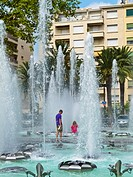Perpignan, France, Father and Daughter Enjoying Public Water Fountains, on Hot day