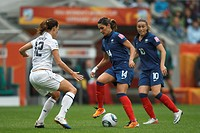 MOENCHENGLADBACH, GERMANY - JULY 13: Louisa Necib of France 14 controls the ball against Lauren Cheney of the United States 12 during a FIFA Women´s W...