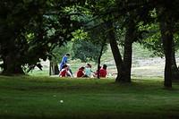 Family playing in the park, Santiago de Compostela, Coruña, Galicia, Spain, Europe