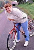 Smiling Woman with Bike