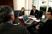 Business people sitting at conference table in meeting
