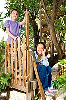 Portrait of siblings in a tree house
