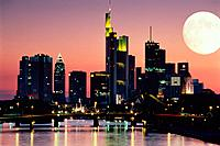 Illuminated skyline of Frankfurt /Main with full moon in the evening light, Germany