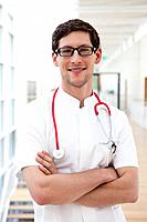 Germany, Bavaria, Diessen am Ammersee, Young doctor with stethoscope, smiling, portrait