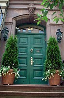 Entrance to to old building with green decorative door, New York City, state of New York, United States, USA