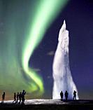 Strokkur Geyser erupting with Northern Lights Digital composite, Iceland