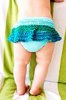 Little baby wearing a ruffled blue skirt