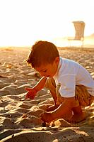 Small boy playing in sand
