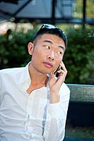 Paris, France, Young Asian Man Talking on Smart Phone, I-Phone on Street