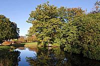 View across the moat towards the park landscape, Luetetsburg castle, Luetetsburg, Lower Saxony, northern Germany