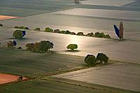 Aerial view of surreal looking fields and rural landscape in a silver light, Lower Saxony, Germany