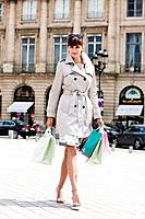 Woman walking on a street, Paris, Ile_de_France, France