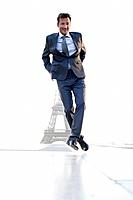 Businessman jumping with the Eiffel Tower in the background, Paris, Ile_de_France, France