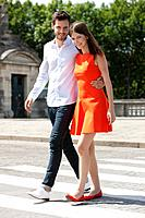 Couple walking with arms around and smiling, Paris, Ile_de_France, France