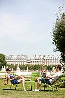 Man using a laptop with a woman sitting in front of him, Jardin des Tuileries, Paris, Ile_de_France, France