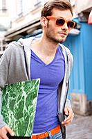Man carrying a file, Paris, Ile_de_France, France