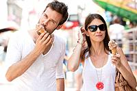 Couple eating ice creams, Paris, Ile_de_France, France