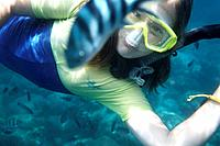 Girl 10 years snorkeling in school of fishes, Island of Ko Tao, Surat Thani, Thailand