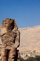 Coloss of Memnon with a nubian village, Luxor, ancient Thebes, Egypt, Africa