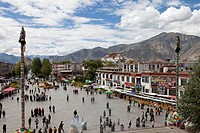 Barkhor Square with pilgrims in the old part of Lhasa with Potal, Tibet Autonomous Region, People´s Republic of China