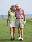 Caucasian couple golfing together