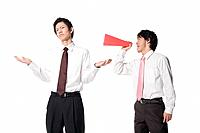Man shouting at colleague with megaphone