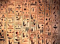 Old egyptian hieroglyphs in the Medinet Habu Temple of the Dead of Ramses III., Luxor, Theben, cr