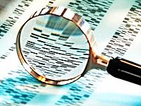 Magnifying glass showing dna coding