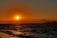 Sunset, sea and mountains