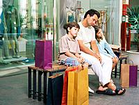 Father and kids bored with shopping