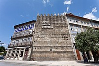 The famous Guimaraes Castle Wall with the inscription 'Aqui Nasceu Portugal' Portugal was born here  Guimaraes, Portugal