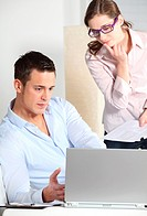 Young couple with laptop in living room
