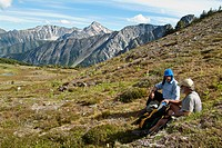 two male hikers in the Cayoosh Range of the Coast Mountains, British Columbia, Canada, near Downton Creek