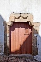 Medieval house door with medieval graffiti on the doorpost  Jewish ghetto, Castelo de Vide  Alentejo, Portugal