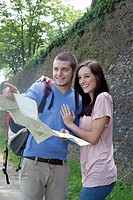 Young couple reading map outdoors