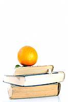 orange on books isolated on white