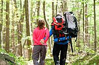 Mature couple hiking in forest