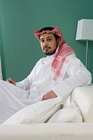 Arab man sitting on sofa